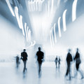 People in the art gallery center abstakt image of lobby of a modern with a blurred background and blue tonality Royalty Free Stock Photos