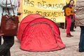People with banner during the demonstration against misery and poverty no eviction without rehousing mulhouse france april text in Stock Photos