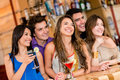 People at the bar happy group of having a drink Stock Photography