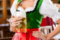 People in Bavarian Tracht in restaurant Royalty Free Stock Photos