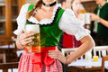 People in Bavarian Tracht in restaurant Royalty Free Stock Image
