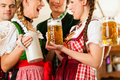 People in Bavarian Tracht in restaurant Stock Photography