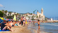 People at beach in sitges catalonia august august catalonia resort town known for its sandy Stock Photo