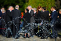 People in blur wearing black suits on funeral Royalty Free Stock Photo