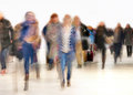 People in blurred motion a hurry Stock Images