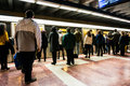 People boarding metro train standing ready to board a in underground station Stock Photo