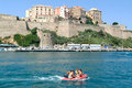 People on a boat in front of calvi corsica france july at corsica island Royalty Free Stock Image