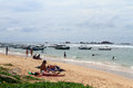 People and boats on the beach in hikkaduwa Royalty Free Stock Photos
