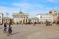 People in brandenburg gate berlin germany april moving the scenic pariser platz where is located the most emblematic landmark of Stock Photo