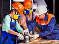 People in builder helmet man and women with electric planer Stock Images