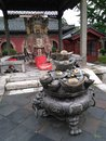 Chinese Temple God And An Incense Burner