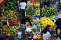 People buy and sell fruit at market.DA LAT, VIET NAM- FEBRUARY 8, 2013 Royalty Free Stock Photo