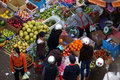 People buy and sell fruit at market. DA LAT, VIET NAM- FEBRUARY 8, 2013 Royalty Free Stock Photo