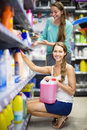 People buying detergents in the shopping mall smiling spanish for house Stock Images