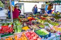 People buying fruits and vegetables at market stall in Portobello Road Market, Notting Hill, United Kingdom