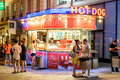 People buying hot dogs at wurstel hot dog stand on graben street in the night vienna austria august Royalty Free Stock Photo