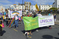 People carrying flags and banners in the colourful Margate Gay pride Parade Royalty Free Stock Photo