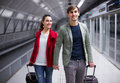 People carrying luggage at metro positive adult terminal Royalty Free Stock Photo