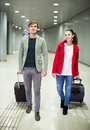 People carrying luggage at metro positive young terminal Royalty Free Stock Image