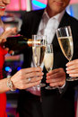 People with champagner in a bar Stock Photography