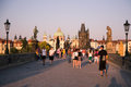 People on the charles bridge prague image showing tourists in czech republic Royalty Free Stock Photo