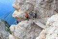 People climbing the Via Ferrata Severino Casara with bridge in Sexten Dolomites mountains, South Tyrol Royalty Free Stock Photo