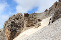 People climbing the Via Ferrata Severino Casara and snow field in Sexten Dolomites mountains, South Tyrol Royalty Free Stock Photo