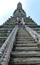 People climbing the wat arun is a buddhist temple in bangkok yai district of bangkok thailand on thonburi west bank of chao phraya Stock Photo