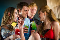 People in club or bar drinking cocktails young and having fun Stock Photography