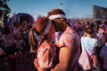 People at the color run event in milan italy september a couple kisses crowd while taking part funniest and most colorful urban Stock Photography