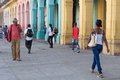 People in a colorful street in havana cuba cubans sidelined by buildings with over million inhabitants is the capital of and the Royalty Free Stock Photos