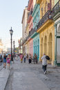 People in a colorful street in havana cuba cubans sidelined by buildings with over million inhabitants is the capital of and the Stock Photography