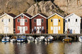 People and colorful wooden fishing sheds on pier along with old in smogen swedish smögen smögen is well known today for its long Stock Image