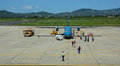 People coming to the airplane at airport in Dalat, Vietnam