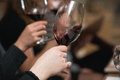 People consider the color of the wine and try how it smells in different glasses