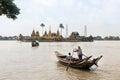 people cross yangon river by boat for pray at Ye Le Paya  pagoda the floating pagoda on small island Royalty Free Stock Photo