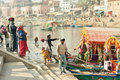 People crossing the river by riverboat of an old indian city Royalty Free Stock Photo