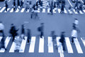 People crossing the street-blue tones Royalty Free Stock Photo