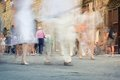 People crowd abstract blur while walking fast moving on the sidewalk city Stock Images