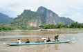 People cruising on a boat in river Mekong