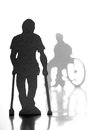 People with crutche cardboard silhouettes of crutches and a wheelchair Royalty Free Stock Images