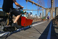 People cycling on Brooklyn Bridge, New York Royalty Free Stock Photo