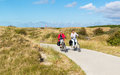 People cycling in dunes of Texel, Netherlands Royalty Free Stock Photo