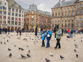 People on the dam square in amsterdam netherlands february Royalty Free Stock Photos