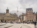 People on the dam square in front of amsterdam royal palace n netherlands february netherlands Royalty Free Stock Images
