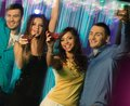 People dancing at night club group of happy young Royalty Free Stock Photography