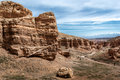 People descend to the bottom of the Charyn canyon