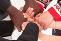 People of different nationalities and religions hold hands. Royalty Free Stock Photo