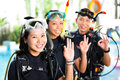 People in diving school students and master asian at the diver course on holiday wetsuit with an oxygen tank Royalty Free Stock Photos