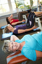 image photo : People doing crunches in gym